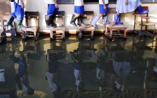 Staying above water to get to a classroom at an elementary school in the Philippines