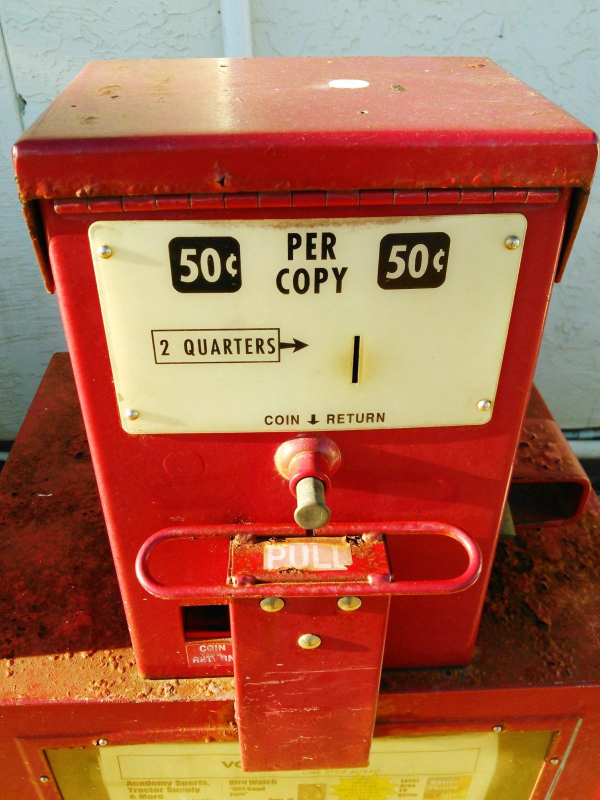 Red newspaper vending machine