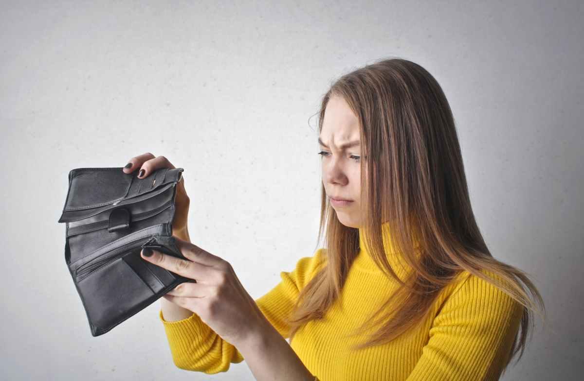 woman holding black wallet