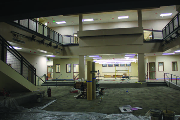 The atrium of the Media Arts Center is still cluttered with construction material as the building nears completion.The estimated completion date and soft move-in of the building is set sometime after spring break with a grad opening in August. Photo by Bryan Wong
