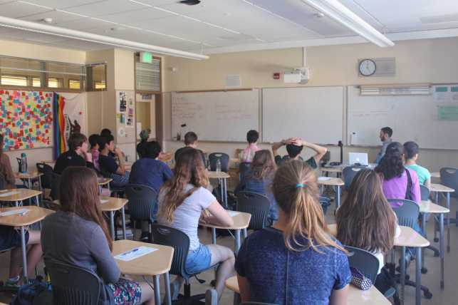 Students meditate in Alexander Davis' sixth period history class