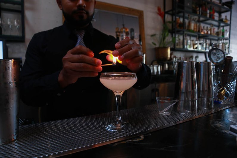 """Golden Dragon - """"I saw it on a netflix show,"""" Viari says. """"A South African bartender was working with gin and juice … we mimicked it but made it different."""" Their drink only contains four ingredients: gin, lemon, sambuca, and simple syrup."""
