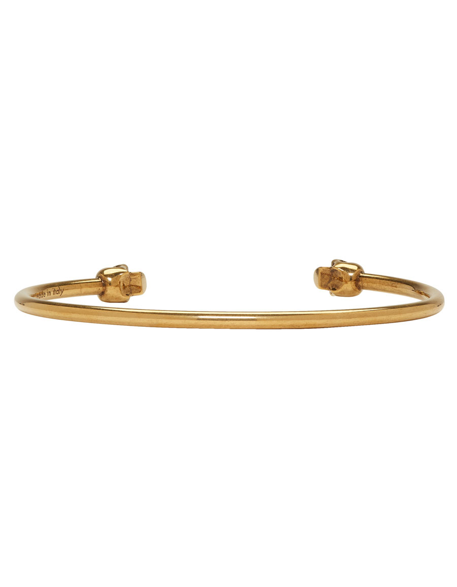 ALEXANDER MCQUEEN Gold Antiqued Thin Twin Skull Bracelet