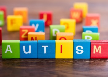Multi Colored Blocks With Text Autism On Table