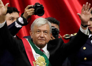 Mexico's new President Andres Manuel Lopez Obrador (with presidential sash) gestures during his inauguration ceremony at Congress, in Mexico City, Mexico December 1, 2018. REUTERS/Henry Romero - RC157305BCF0