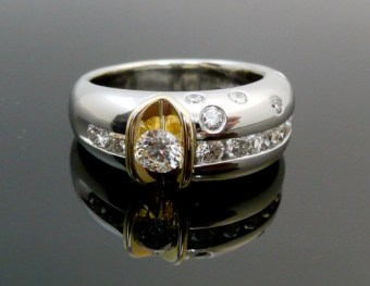 Skyline themed custom designed and fabricated engagement ring with diamonds as twinkling city lights