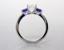 Three stone sapphire and diamond engagement ring in 14K recycled white gold.