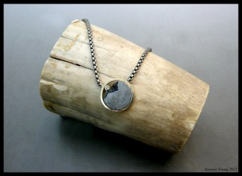 Meteorite and gold necklace