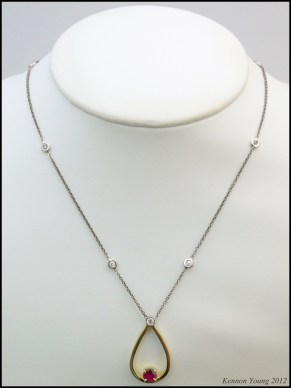 14K yellow and white gold necklace with diamond melee and a natural ruby