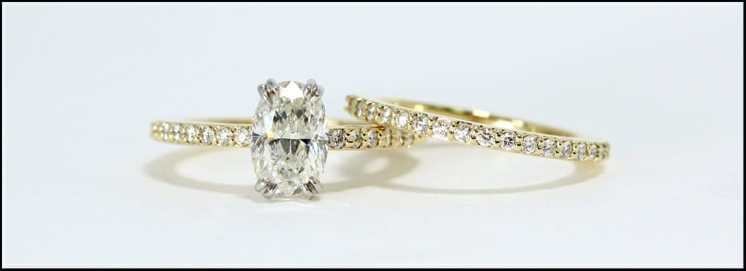 Oval diamond and skinny band platinum and yellow gold engagement and wedding band set
