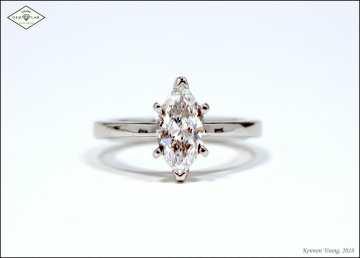 marquise solitaire engagement ring in platinum