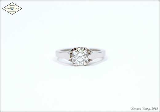 """""""Brooklyn"""" themed diamond solitaire engagement ring in platinum"""