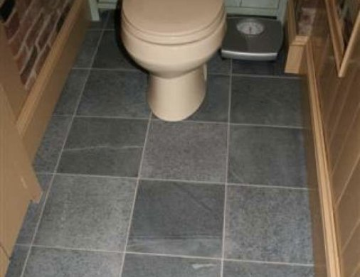 Bathroom Flooring     Vermont Soapstone Vermont Soapstone manufactured and installed the flooring system in this  lavatory