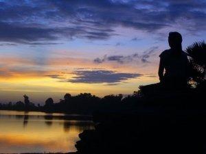 woman-praying-at-sunrise