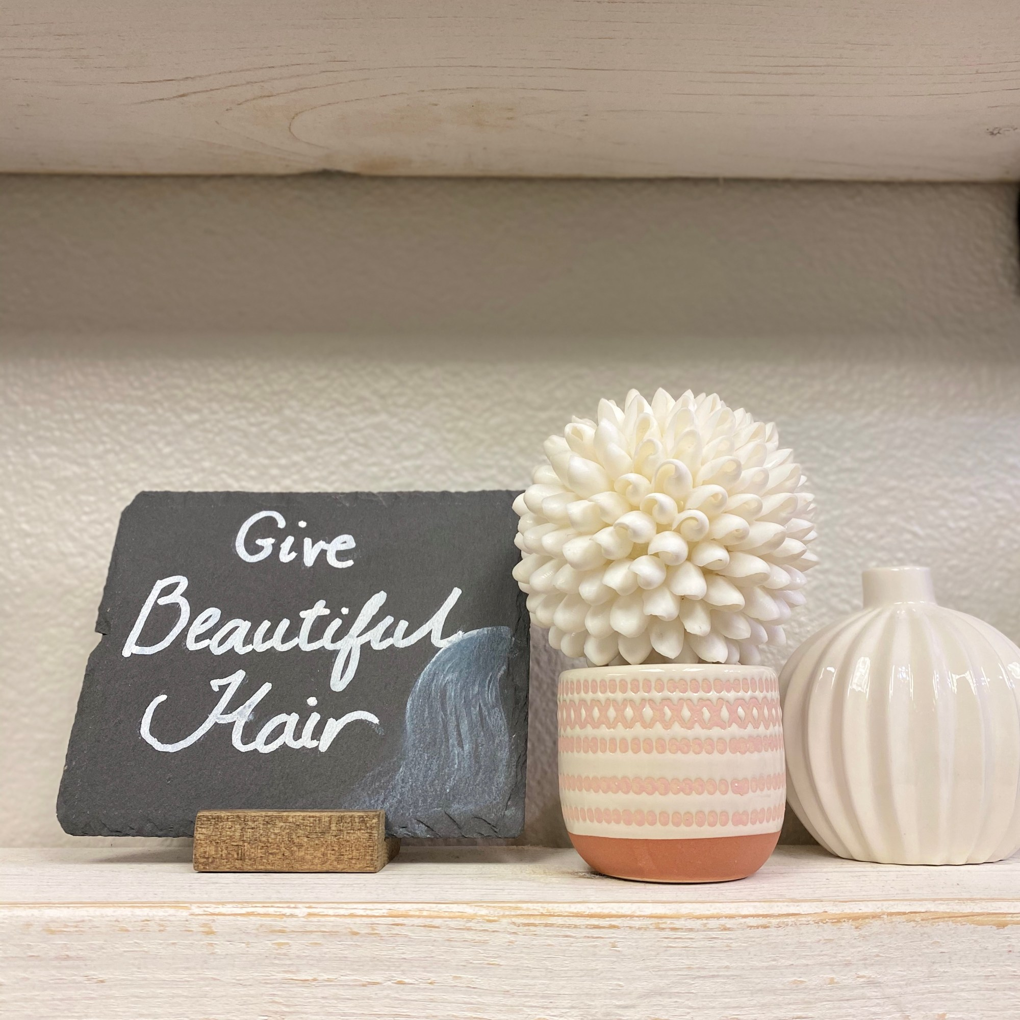 Give beautiful hair plaque on salon shelves