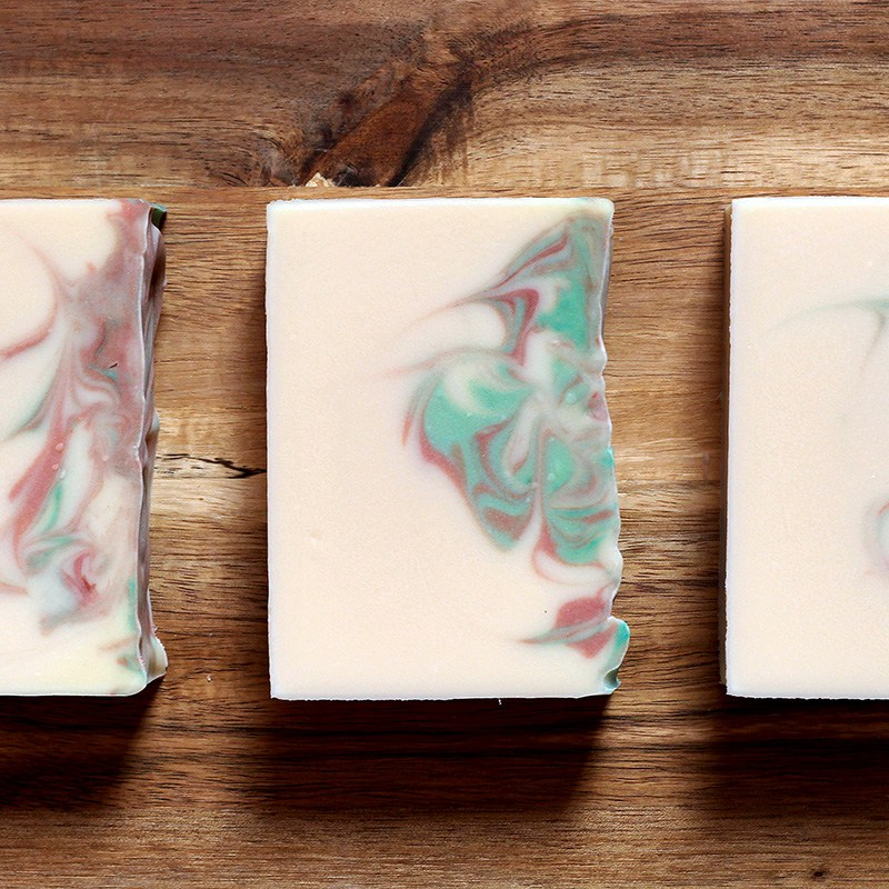 White creamy soap, with green and red swirls.
