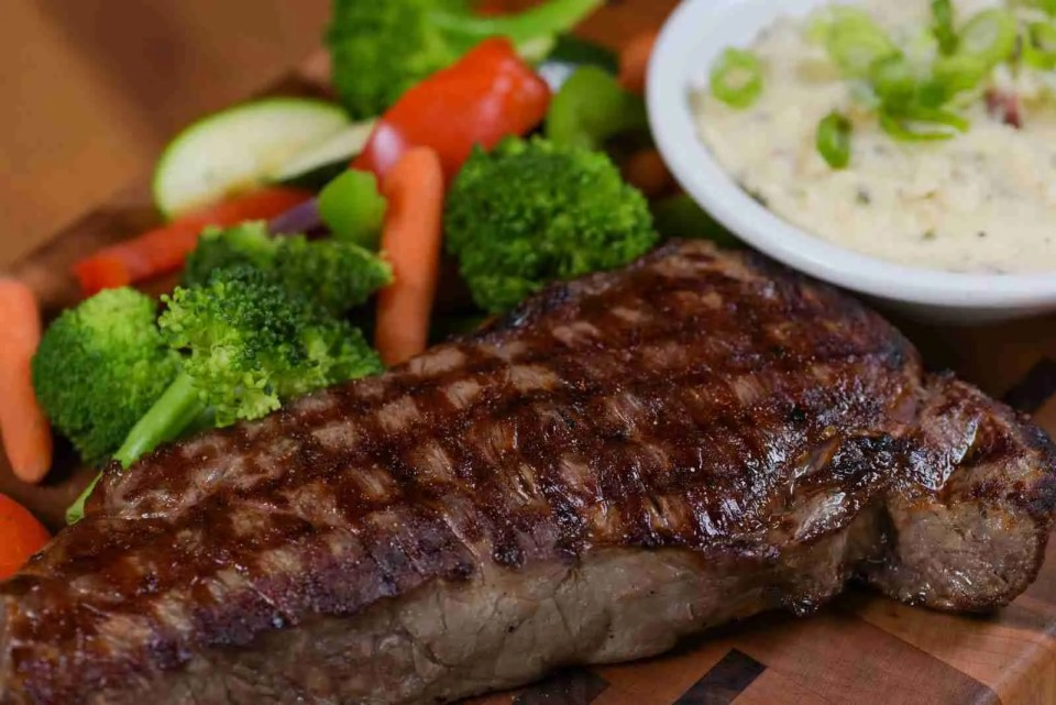 A steak with side of vegetables from Crazy Horse - best place to eat in Holland, Michigan