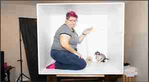 slightly skewed image of a woman in a box