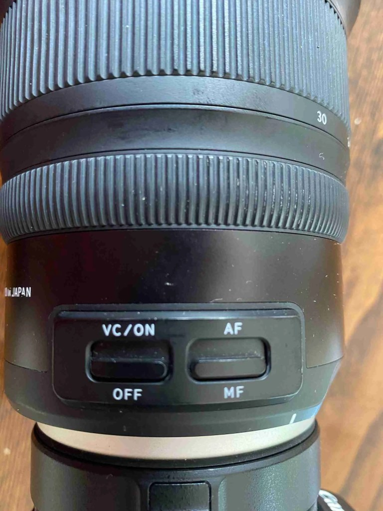 Camera Lens showing Vibration Control and Manual Focus switches used when photographing stars
