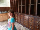 This amazing cabinet had been restored, with a temporary modern sink cabinet beside it.