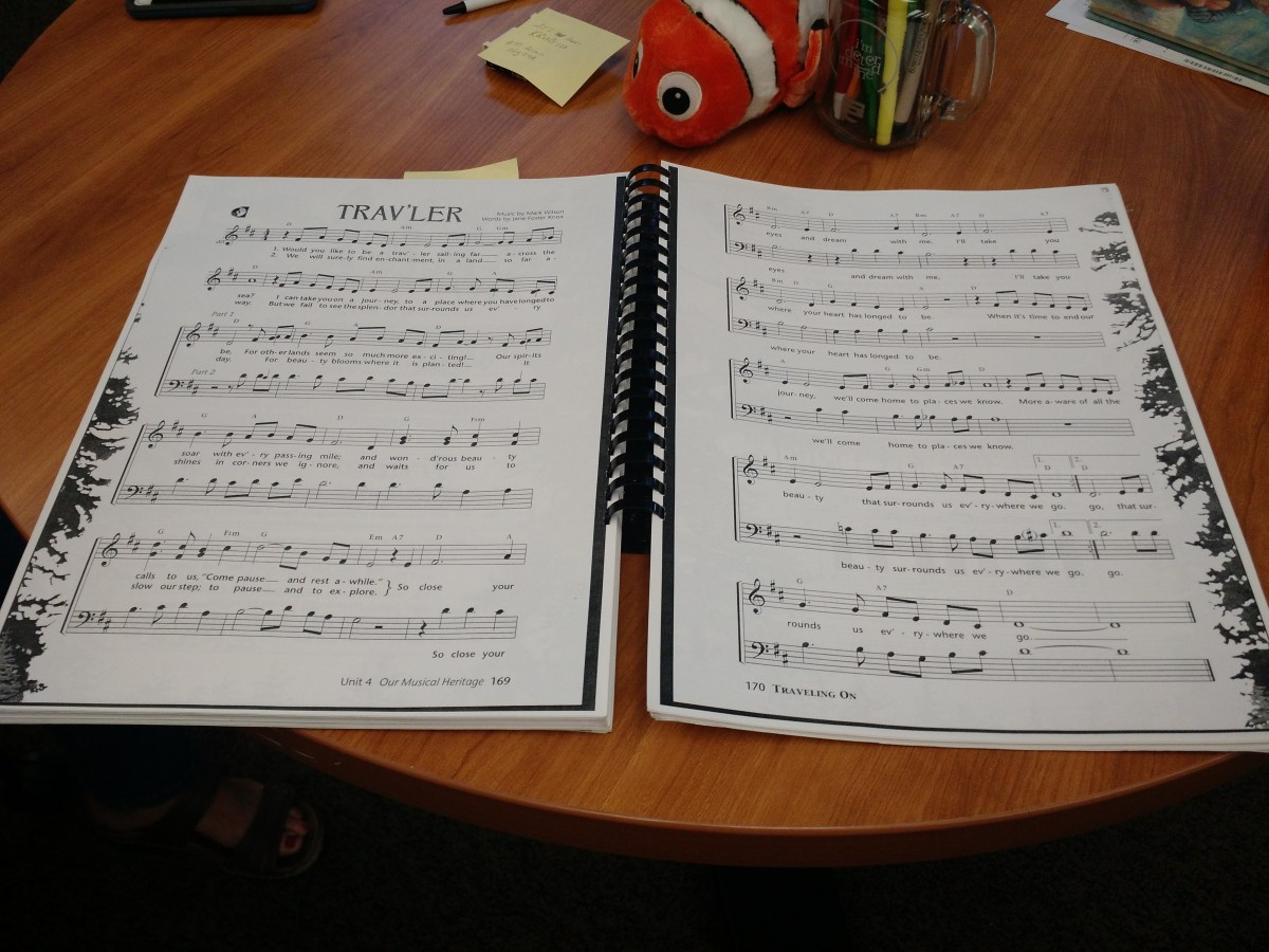 an 11 x 14 spiral bound book with music on a table