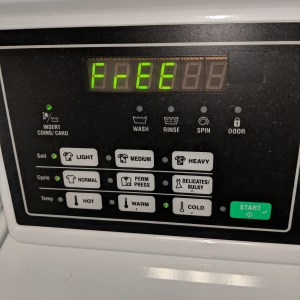 A washing machine with settings enabled for a light soil, normal fabric, cold water wash cycle