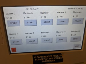 a touchscreen menu that displays which machines are available, with a start button for each machine located directly below the text