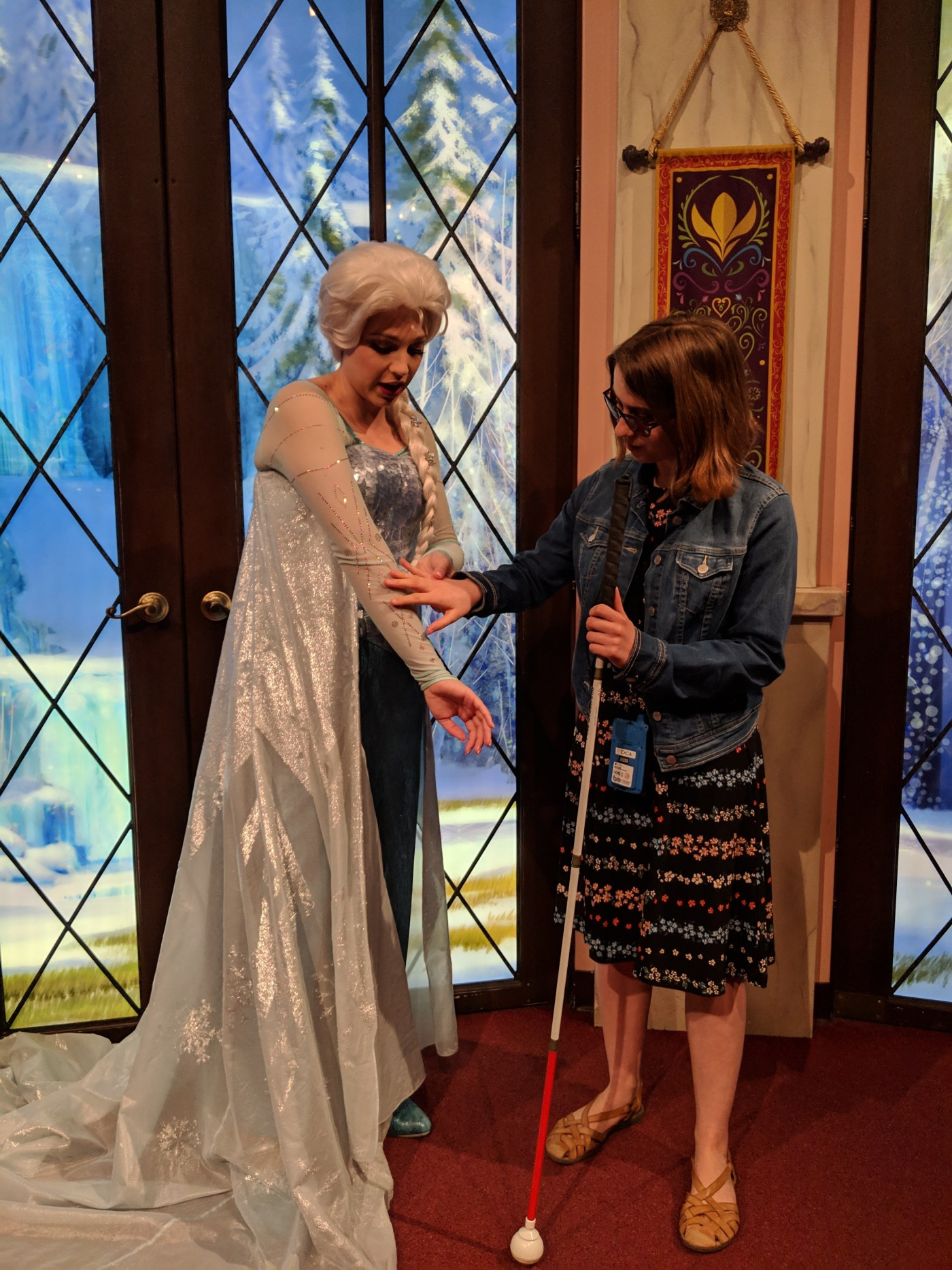 Veronica feeling the embroidery on princess Elsa's sleeve