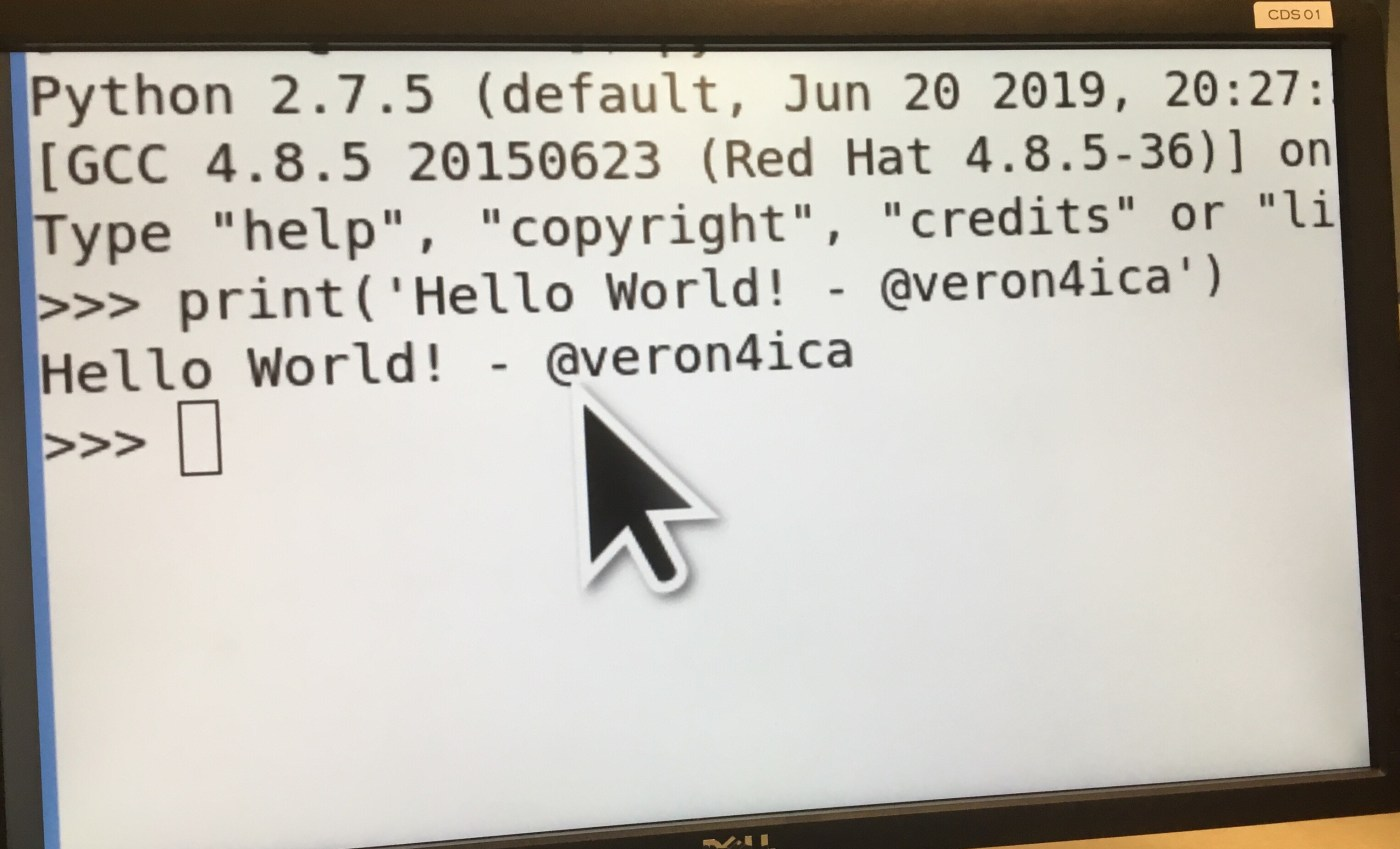 "Python terminal open with the text ""Hello World! - @veron4ica"" written onscreen"