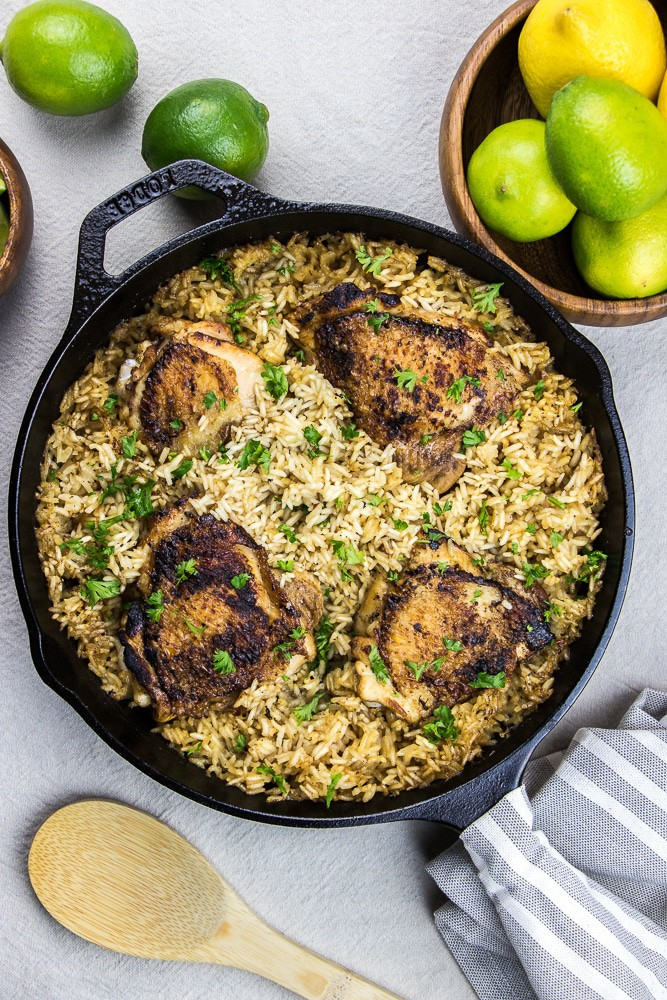 One Pot Chicken and Rice baked in an oven is a great recipe for busy nights. Lime marinated chicken thighs bring out a tangy flavor, which compliments the whole dish.