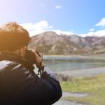 man-taking-photo-of-mountain-450054