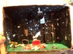 """Scrotus made this insect habitat diorama. It's occupied a very visible spot for several months. I took lots of pictures and am going to """"retire"""" it."""