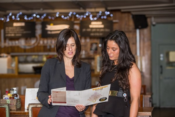 Helen Bailey of Aviatrix with the manager of Walkabout in Temple, London discussing the menu there in relation to a focus group