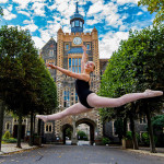 A female ballet dancer leaps in front of Brighton College