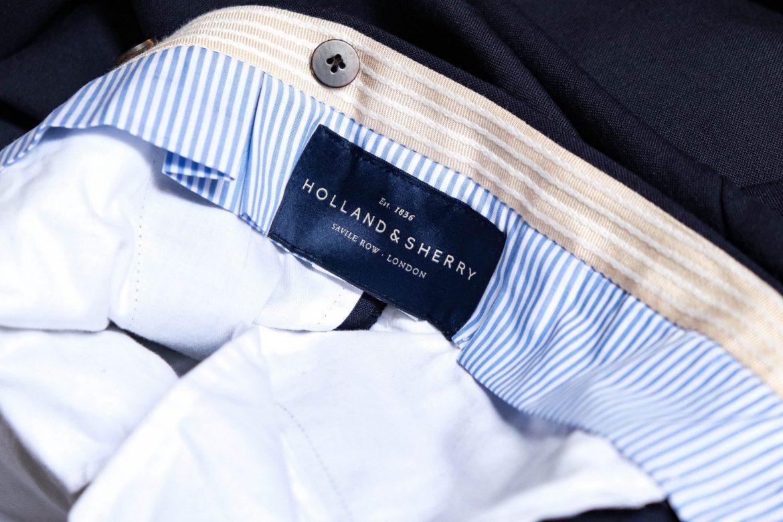 Etiquette Holland and sherry intérieur de pantalon de costume homme bleu marine.