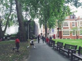 Rich kids running around a park after school.