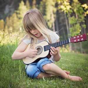 girl plays guitar_music therapy autism special needs