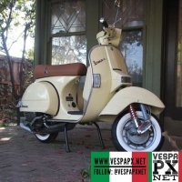 Vespa PX in vintage cream and white wall, classy