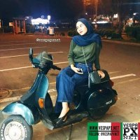 Dark green Vespa excel T5 with Vespa girl . hashtag and mention @vespapxnet for feature repost