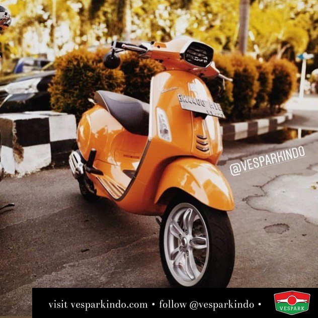 Orange Vespa Sprint with Primavera ABS wheels. Order yours at Vespark @faisalzulfikar