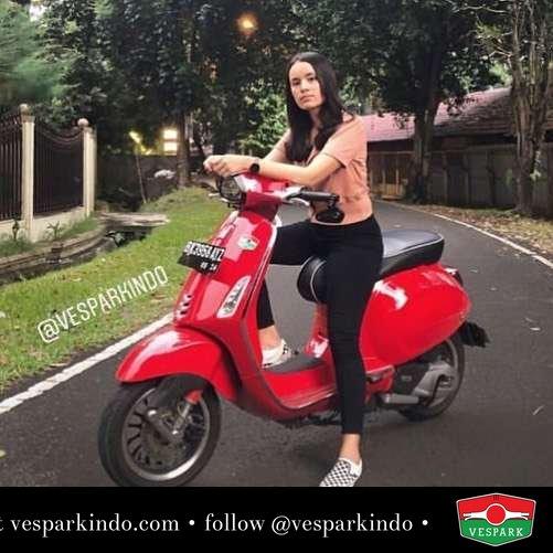 Red Vespa Sprint with vespa girl @angellsrg