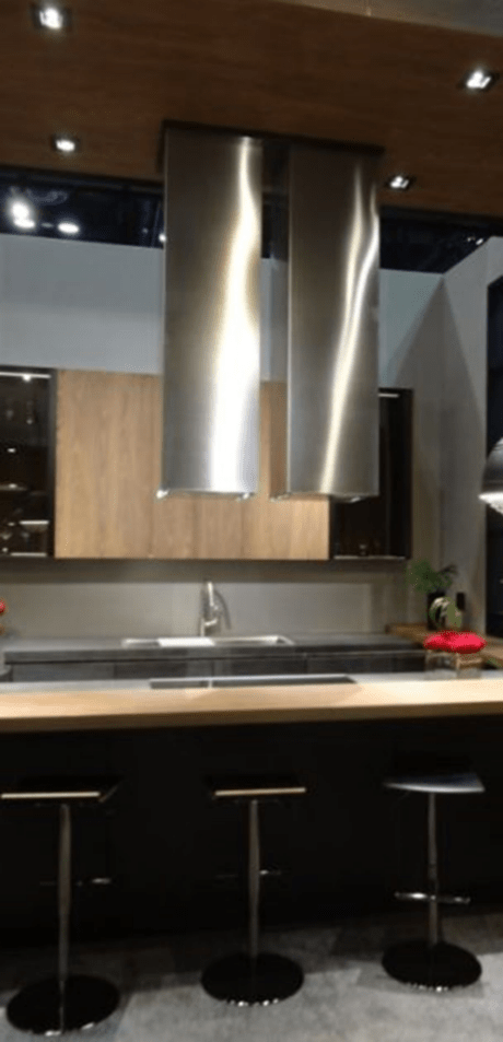 Add style to your kitchen design by doubling up your hoods.
