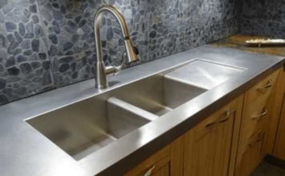 Double stainless steel sink integrated into counter
