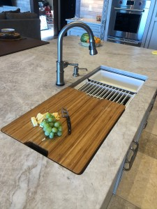 "cutting board and white accessories in 42"" wide sink"
