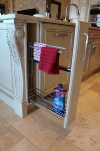 accessory inside narrow cabinet for tea towels and detergents