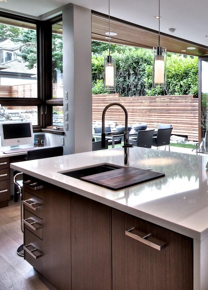 large single sink with walnut cutting board