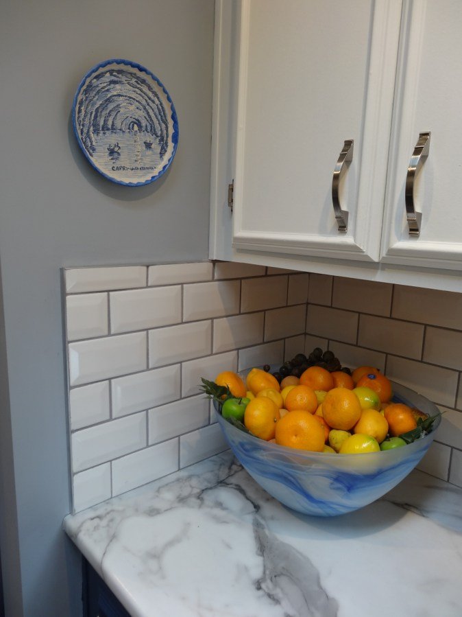 Subway tile backsplash detail in corner