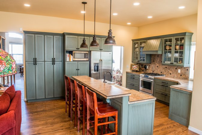 For a retro, vintage look choose Cottage style for the kitchen decor style. Bead board, glass cabinet doors and craftsman details are hallmarks of this style.
