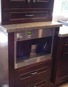 coffee maker built into a base cabinet
