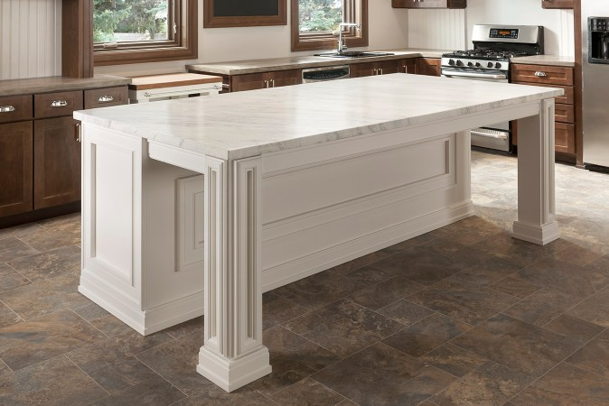 kitchen island trimmed with moulding and painted white
